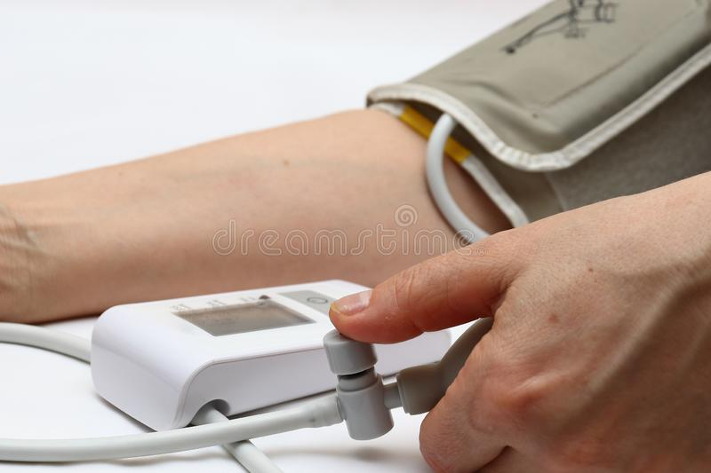 Blood pressure measurement with a tonometer. Cuff for air, pear for inflation, connecting ducting soft rubber tubes. Blood pressure measurement with a tonometer stock photo