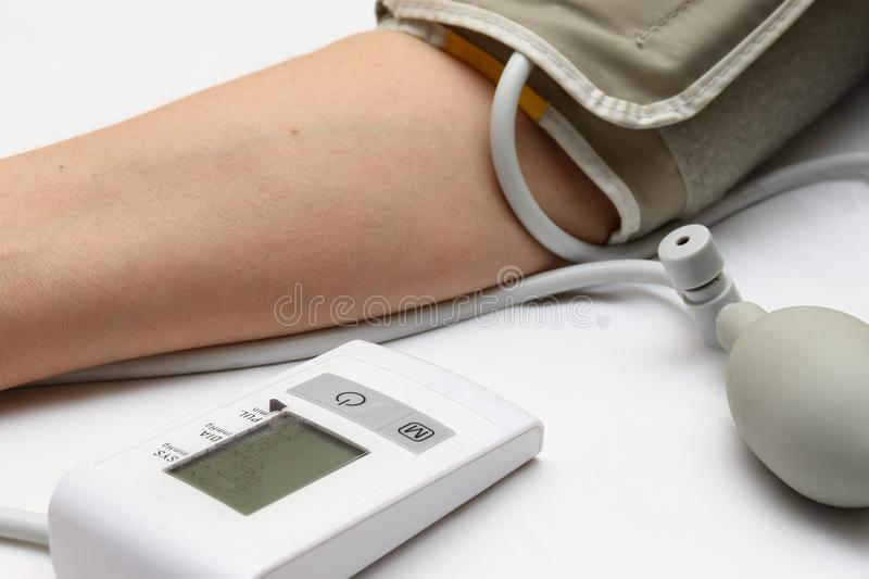 Blood pressure measurement with a tonometer. Cuff for air, pear for inflation, connecting ducting soft rubber tubes. Blood pressure measurement with a tonometer royalty free stock images