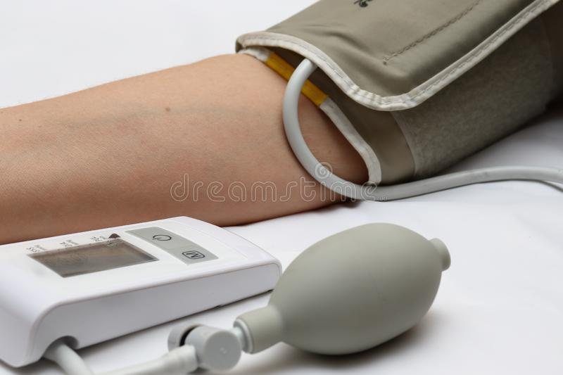 Blood pressure measurement with a tonometer. Cuff for air, pear for inflation, connecting ducting soft rubber tubes. Blood pressure measurement with a tonometer royalty free stock image