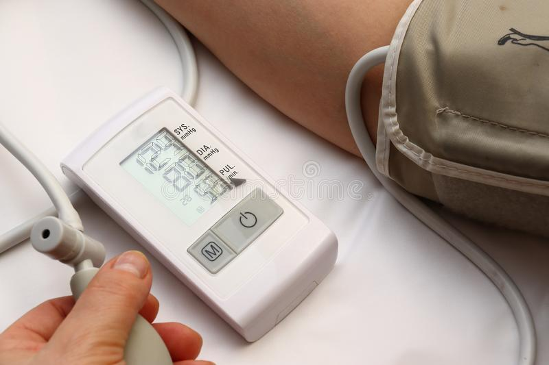 Blood pressure measurement with a tonometer. Cuff for air, pear for inflation, connecting ducting soft rubber tubes. Blood pressure measurement with a tonometer stock photos