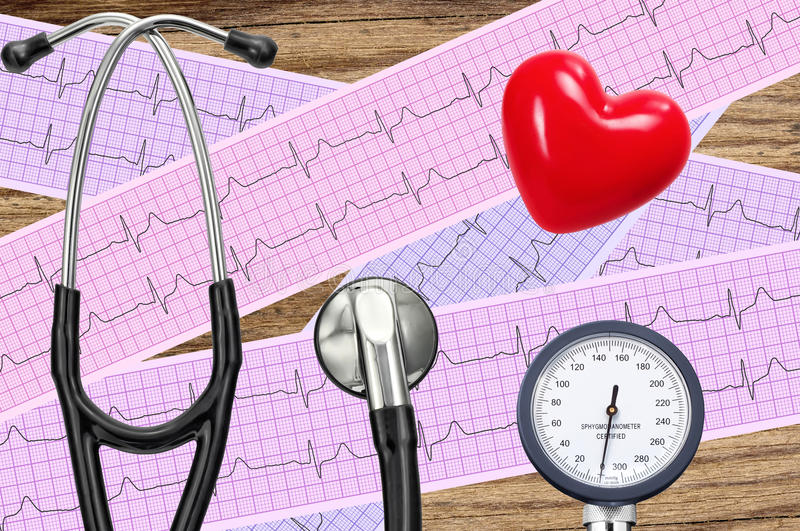 Blood pressure meter, digital tablet and stethoscope, on wooden royalty free stock photos