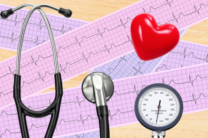 Blood pressure meter, digital tablet and stethoscope, on wooden stock images