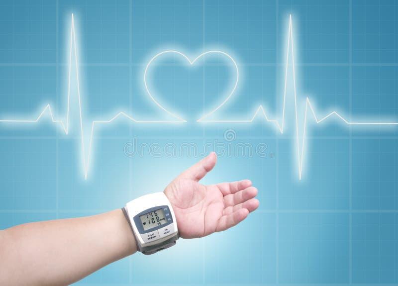 Blood pressure meter on man wrist stock photography