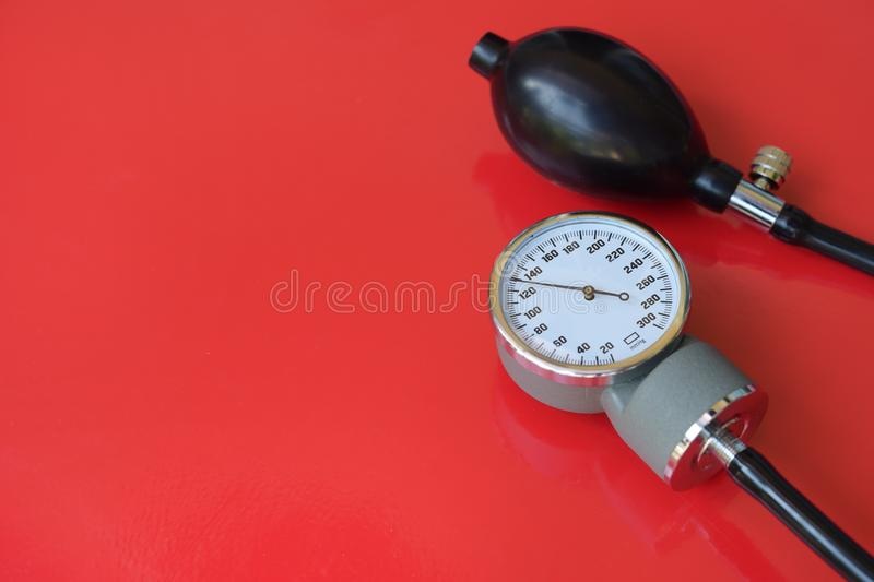 Blood pressure meter medical equipment. On red background royalty free stock photo