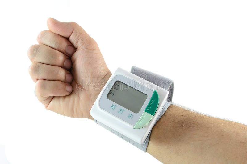 Blood pressure meter on wrist royalty free stock photography