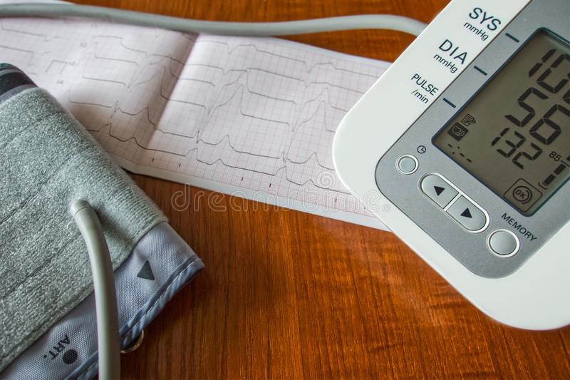 Blood pressure monitor, blood pressure monitor cuff, cardiogram printout. Healthcare concept royalty free stock photography