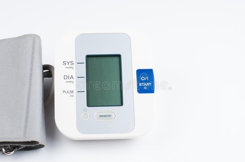 Blood pressure monitor isolated on white background. Medical equipment.Copy space. Diagnostic, test, check, heart, measure, measurement, electronic, digital stock images