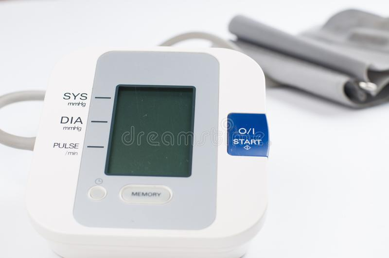 Blood pressure monitor isolated on white background. Medical equipment.Copy space. Diagnostic, test, check, heart, measure, measurement, electronic, digital royalty free stock photo