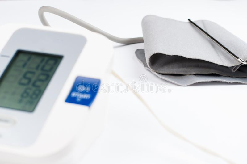 Blood pressure monitor isolated on white background. Medical equipment.Copy space. Diagnostic, test, check, heart, measure, measurement, electronic, digital stock photos