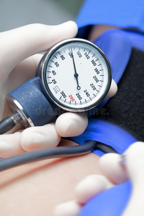 blood pressure of the patient. The doctor measuring blood pressure royalty free stock photos