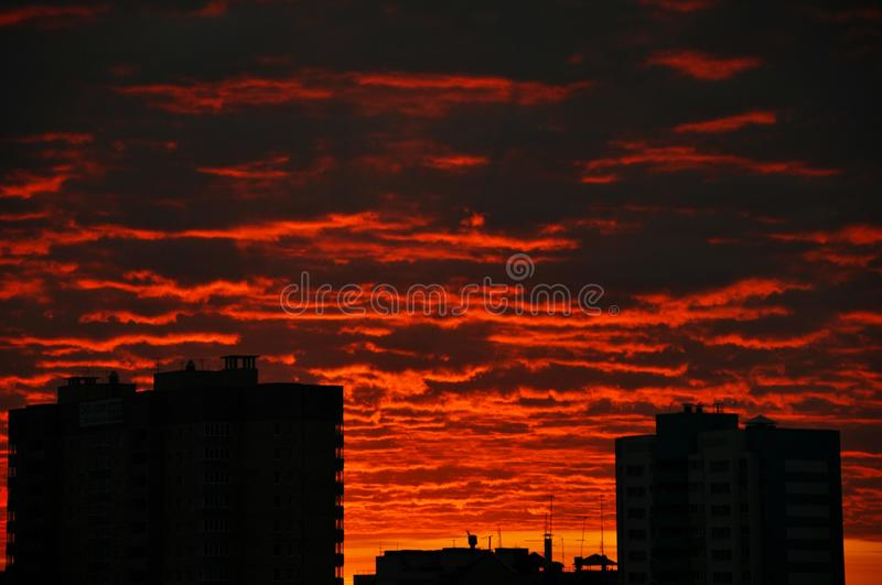 Blood-red clouds at sunset in the city. Home royalty free stock photos