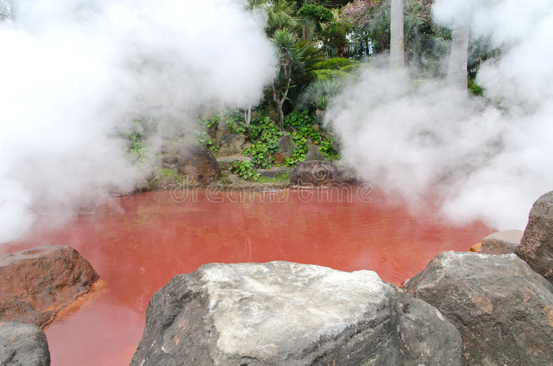 Blood red hot spring in Beppu. A blood like hot spring in the Kamado Jigoku, or cooking pot hell attraction in Beppu. Ferrous Oxide in the water tints it the royalty free stock photo