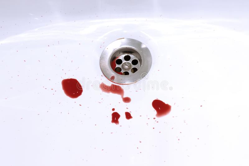 Blood stains in the bathroom sink, bleeding, criminal and suicide concept.  stock photo