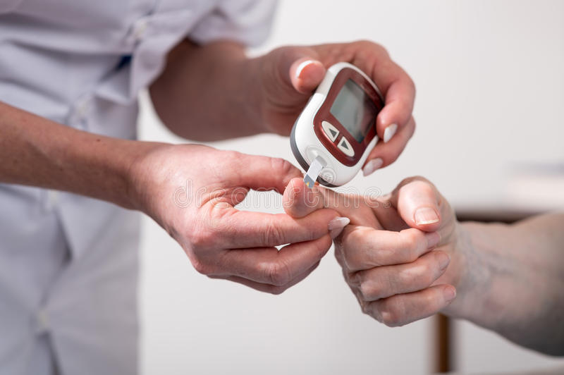 Blood sugar level checking stock photography