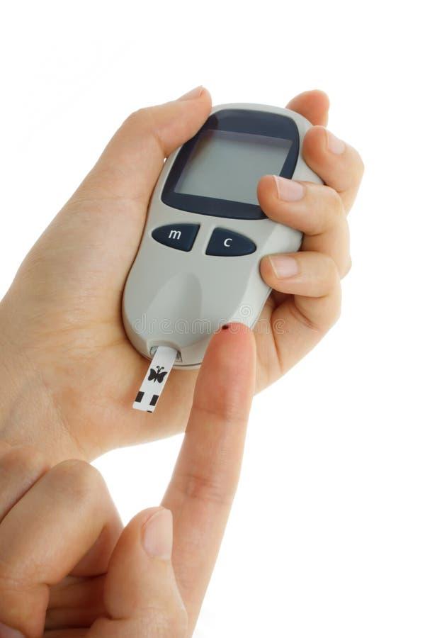 Blood sugar test. On white background royalty free stock photo