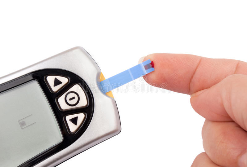 Blood test. One person with diabetes doing a blood test with a glucometer stock photography
