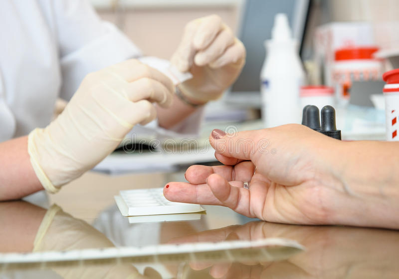 Blood test. Nurse and patient royalty free stock image
