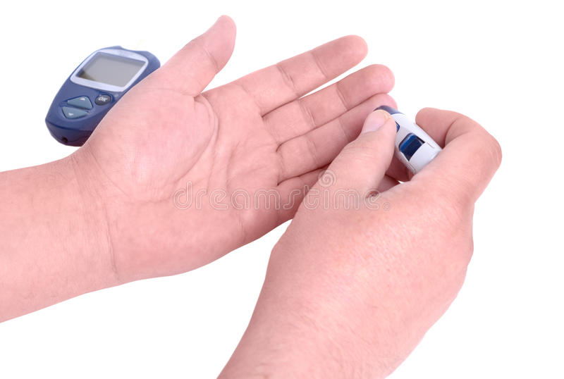 Blood test. Man hands checking blood sugar level by Glucose mete. R. Isolated on white background stock photography