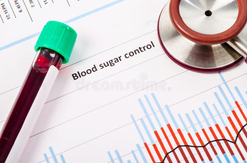 Blood tube on blood sugar control chart. Sample blood for screening diabetic test in blood tube on blood sugar control chart royalty free stock image