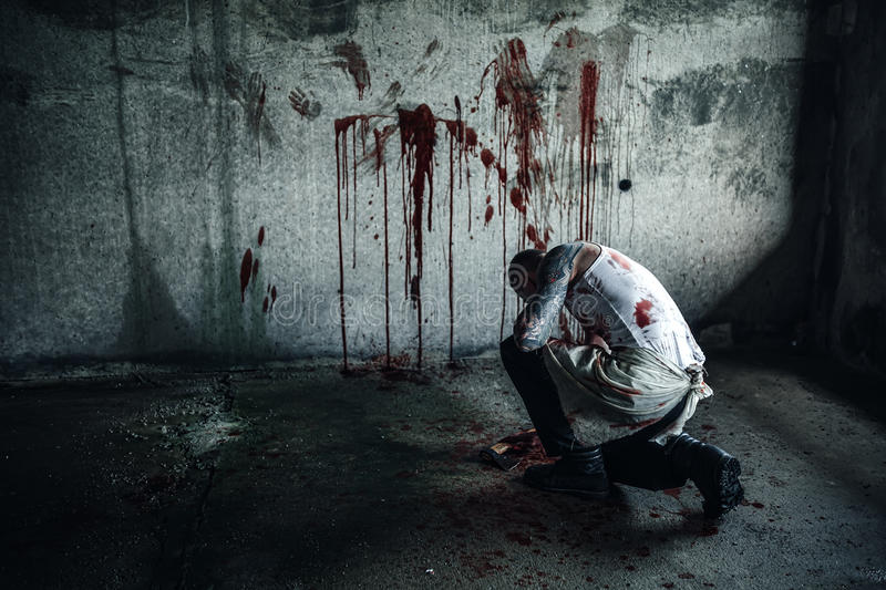 Bloody clown-maniac with ax royalty free stock image