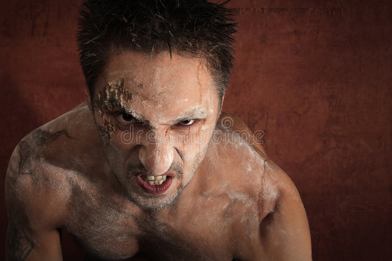 Bloody demon. Demon from hell on a bloody background stock photography