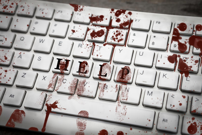 Bloody fingerprints on keyboard with word help stock photos