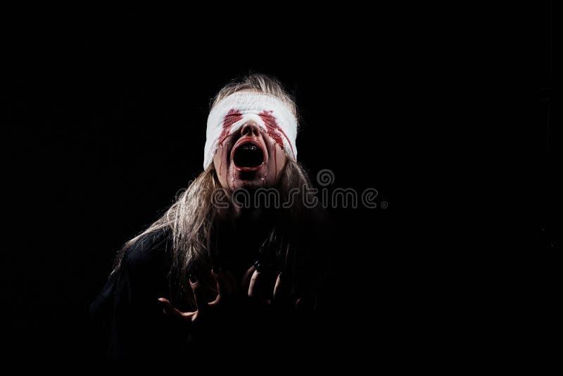 Bloody girl screaming royalty free stock photo