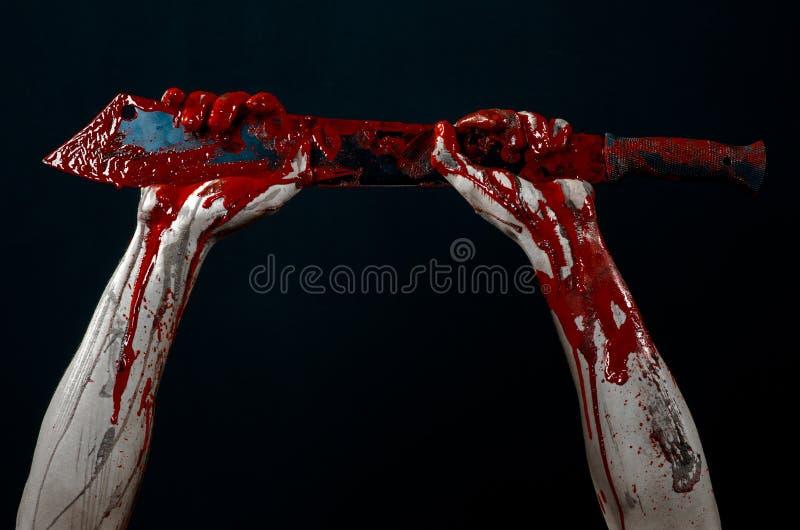 Bloody hands with a machete zombie demon maniac knife stock photo