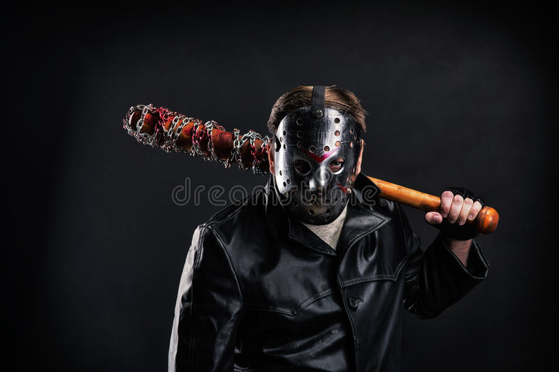 Bloody maniac in mask and black leather coat royalty free stock images