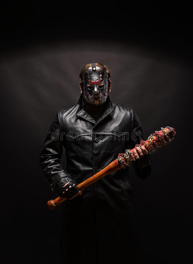 Bloody maniac in mask and black leather coat royalty free stock photos