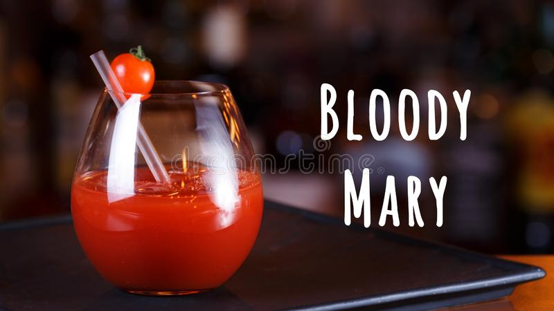 Bloody Mary or Ceasar cocktail at the bar counter. Classic cocktail. Bloody mary wording. Bloody Mary or Ceasar cocktail at the bar counter. Classic cocktail royalty free stock image