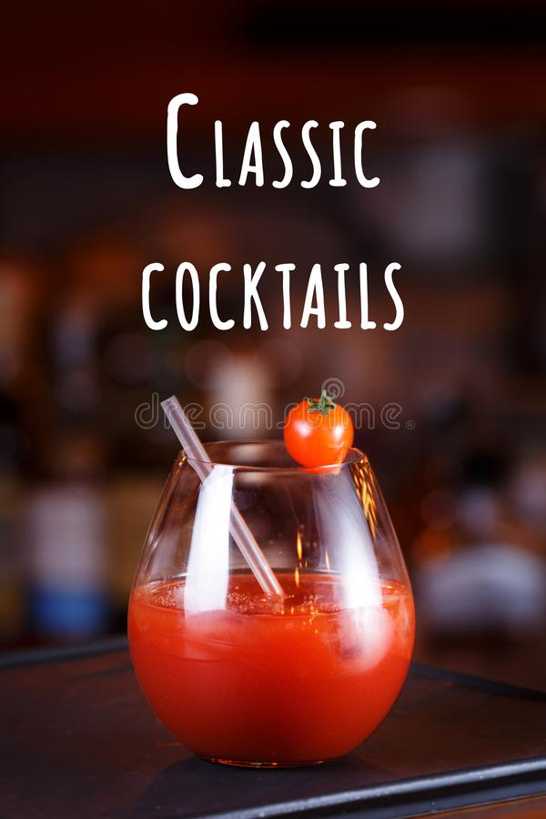 Bloody Mary or Ceasar cocktail at the bar counter. Party and vacation concept. Classic cocktails wording. Bloody Mary or Ceasar cocktail at the bar counter royalty free stock photos
