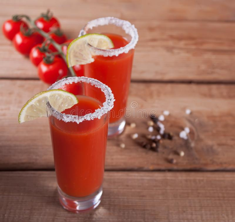 Bloody Mary Cocktail in glasses. Tomato Bloody Mary spicy drink on the wooden table royalty free stock photos