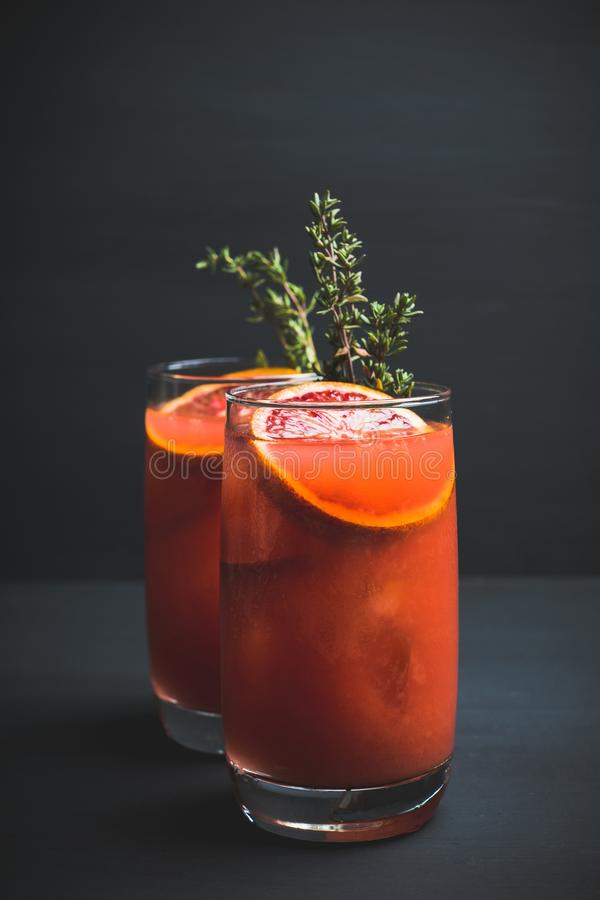 Free Bloody Oranges Beverage With Thyme Stock Photography - 142288172