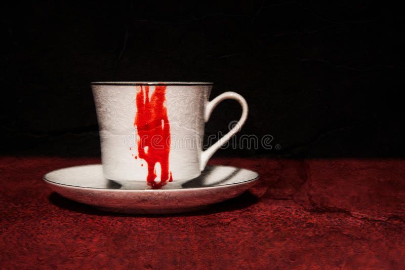 Bloody Vampire Teacup. A bloody teacup fit for a vampire; horizontal image; texture added stock photos