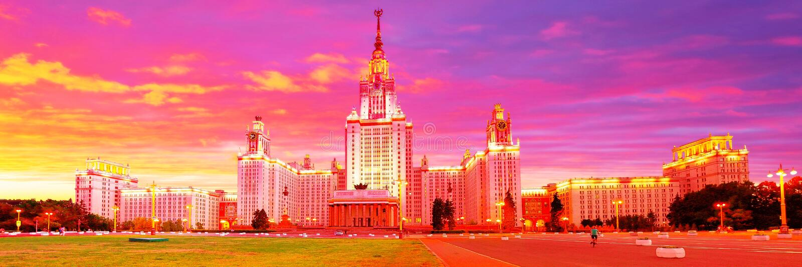 Dramatic wide angle panoramic evening view of illuminated famous Russian university  under bright dramatic evening sky royalty free stock photos