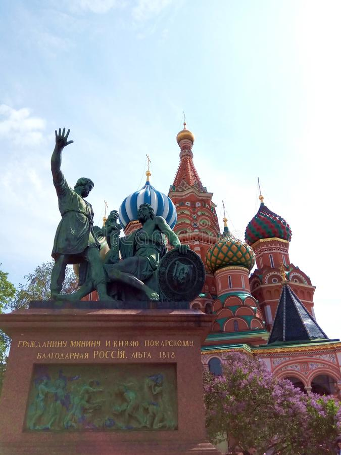 blooming lilac in front of St. Basil& x27;s Cathedral in Moscow. monument to Minin and Pozharsky. stock images
