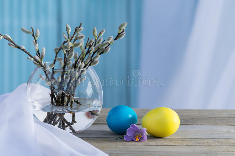 Blooming willow with colored eggs royalty free stock photo