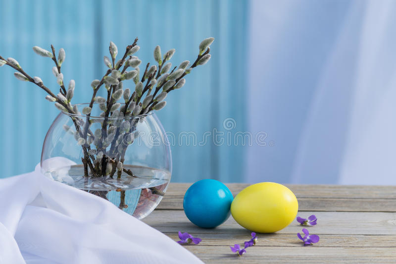 Blooming willow with Easter eggs stock photos