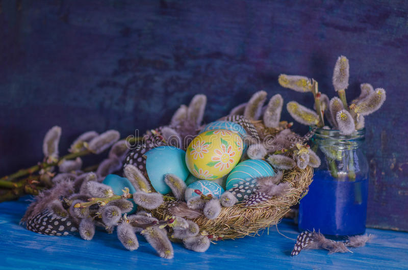 Blooming willow and Easter eggs stock photos