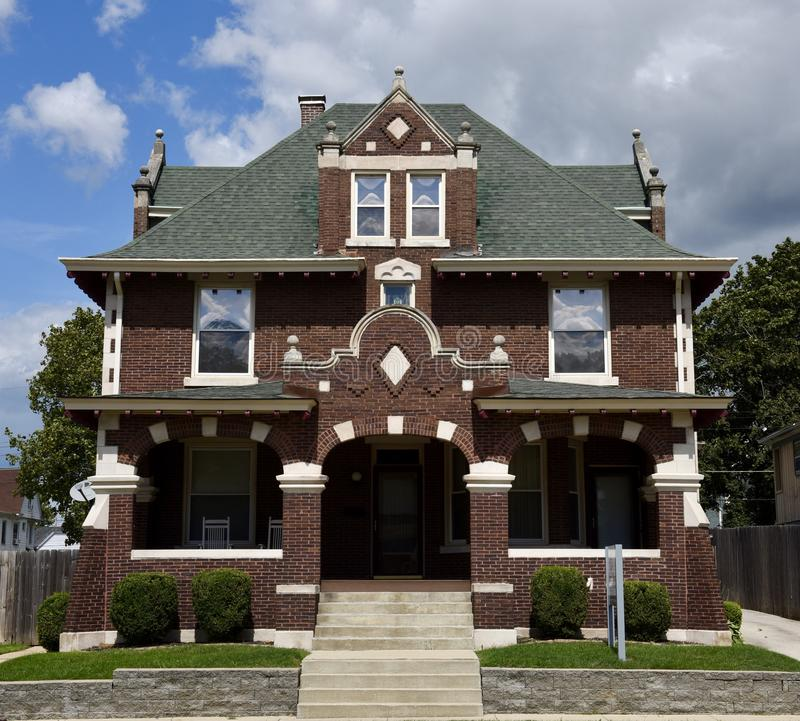 Bloomington Italianate Architecture. This is a Summer picture of a three-story house in Bloomington, Illinois in McLean County. This brick house is an example of royalty free stock image