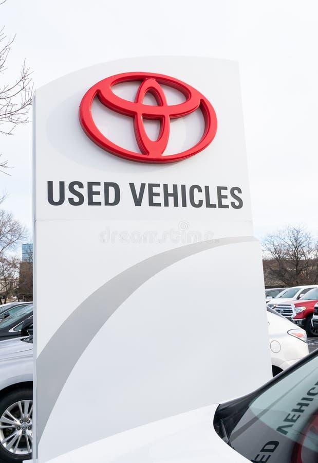 Toytota Used Car Sign and Logo. BLOOMINGTON, MN/USA - NOVEMBER 18, 2018: Toyota automobile dealership used car sign and trademark logo royalty free stock photography