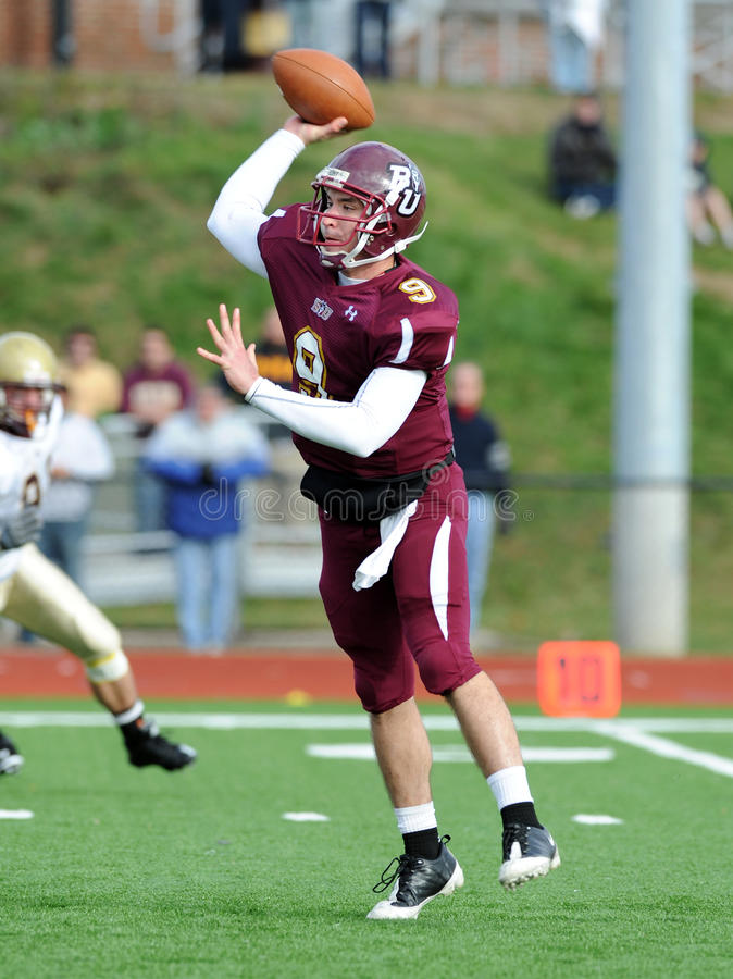 Bloomsburg quarterback Pat Carey. BLOOMSBURG, PA - NOVEMBER 6: Bloomsburg quarterback Pat Carey (#9) throws a pass on the run in a game against Kutztown November royalty free stock images