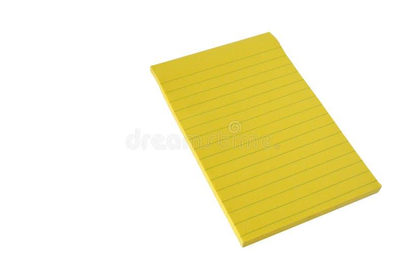 Bloque alineado aislado de documento amarillo sobre un fondo blanco Nota fotografía de archivo