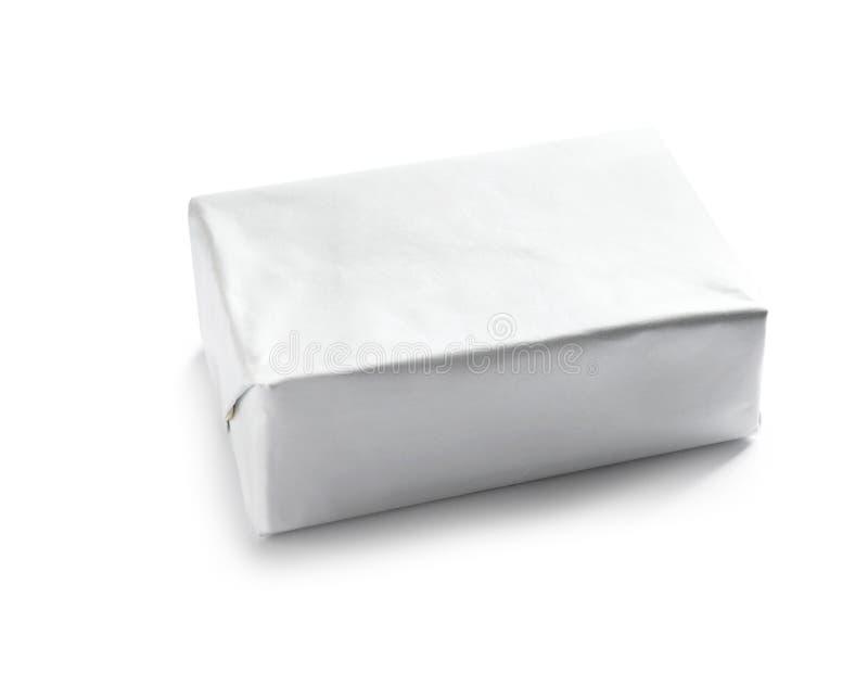 Bloque de mantequilla en envoltura de papel foto de archivo libre de regalías