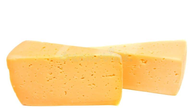 Bloque del queso aislado en el recorte blanco del fondo foto de archivo