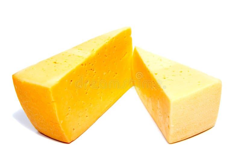 Bloque del queso aislado en el recorte blanco del fondo fotografía de archivo