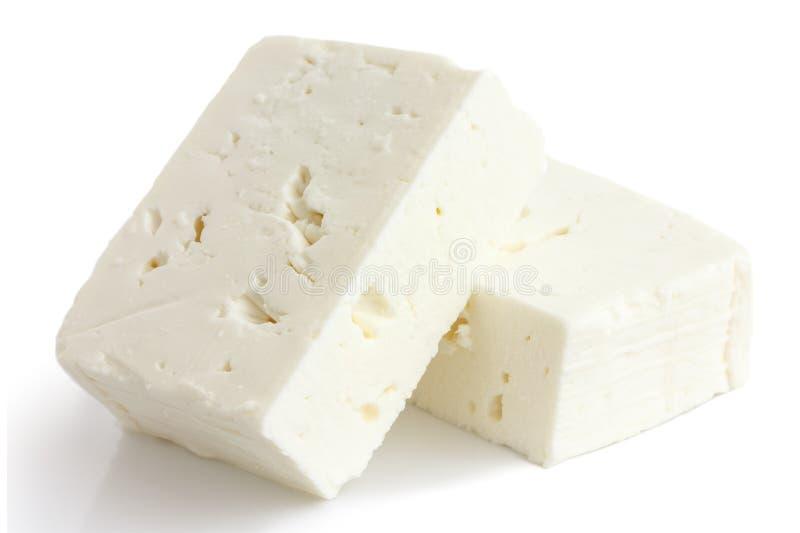 Bloque griego del queso feta aislado en blanco imagen de archivo