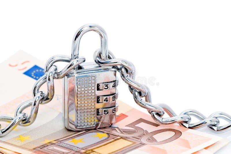 Bloqueo, encadenamientos y dinero imagen de archivo libre de regalías