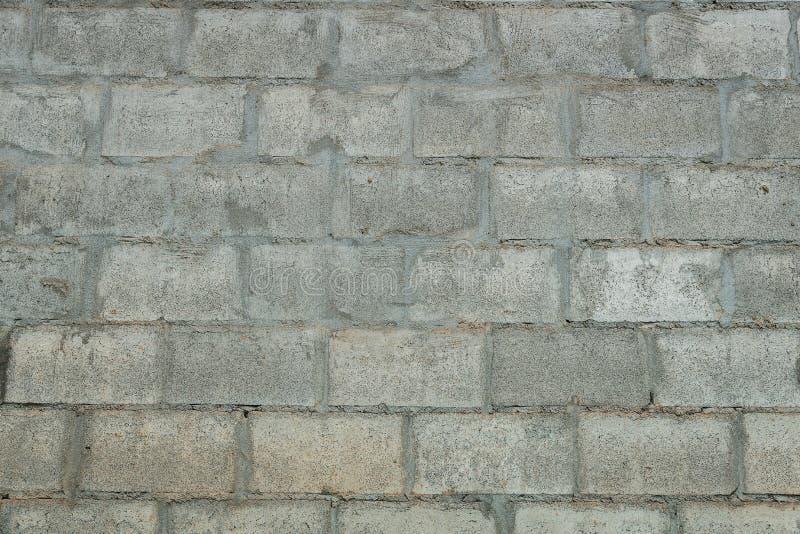Bloques de cemento grises pared, textura inconsútil de la foto del fondo fotos de archivo